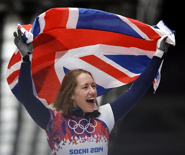 Elizabeth Yarnold of Great Britain celebrates her gold medal win during the women's skeleton competition at the 2014 Winter Olympics, Friday, Feb. 14, 2014, in Krasnaya Polyana, Russia. (AP Photo/Dita Alangkara)