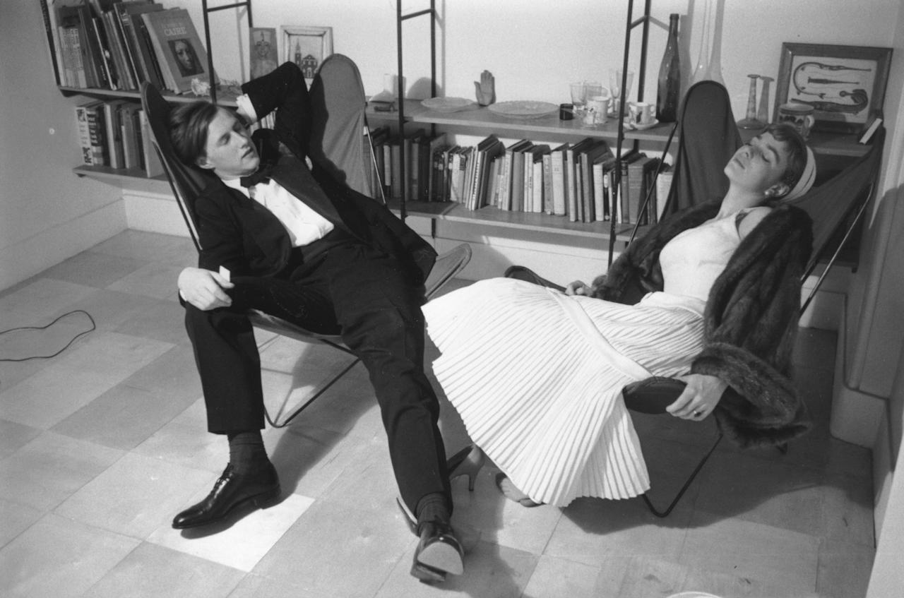 June 1955:  Designer and restauranteur Sir Terence Conran, founder of Habitat, with his wife journalist and author Shirley relaxing at home in hammock chairs. Original Publication: Picture Post - 8083 - Twenty Shillings Or Twenty Pounds -  unpub.  (Photo by Thurston Hopkins/Picture Post/Hulton Archive/Getty Images)