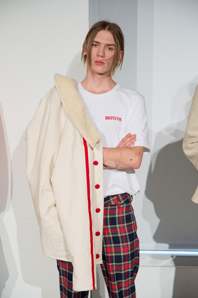 <p>A logo tee paired with plaid pants and a casual jacket is the laid-back menswear vibe we all can't help but love. (Photo: Getty Images) </p>