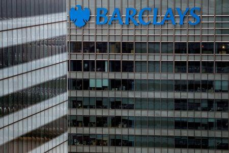 Barclays swings to net loss but promises bigger dividend in 2018