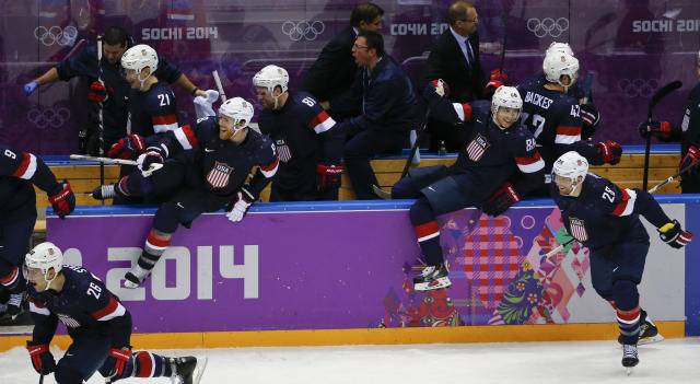 Team USA jumps out of the box after USA forward T.J. Oshie scored the winning goal against Russia in a shootout of overtime of a men's ice hockey game at the 2014 Winter Olympics, Saturday, Feb. 15, 2014, in Sochi, Russia. (AP Photo/Petr David Josek)