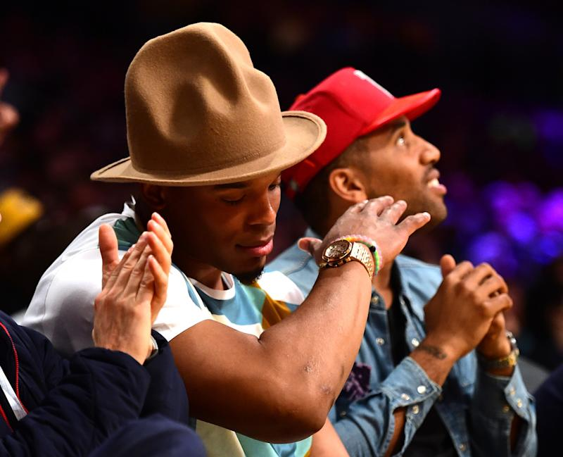 41218329d66 Pharrell s Giant Arby s Hat Reappears on Cam Newton s Head