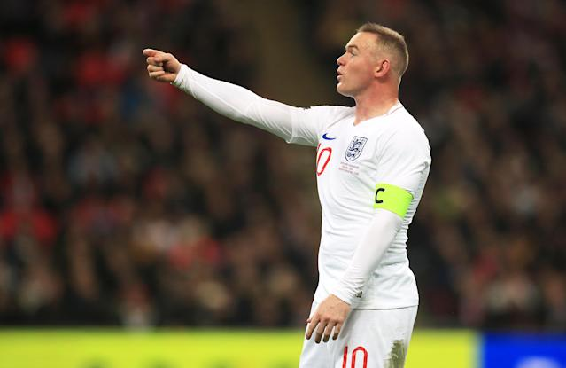 Rooney soon takes over as captain from Fabian Delph (Mike Egerton/PA)