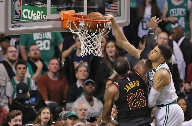 "If you threw down a dunk like that over <a class=""link rapid-noclick-resp"" href=""/nba/players/3704/"" data-ylk=""slk:LeBron James"">LeBron James</a>, you'd frame a massive photo of it too. (Matthew J. Lee/The Boston Globe via Getty Images)"