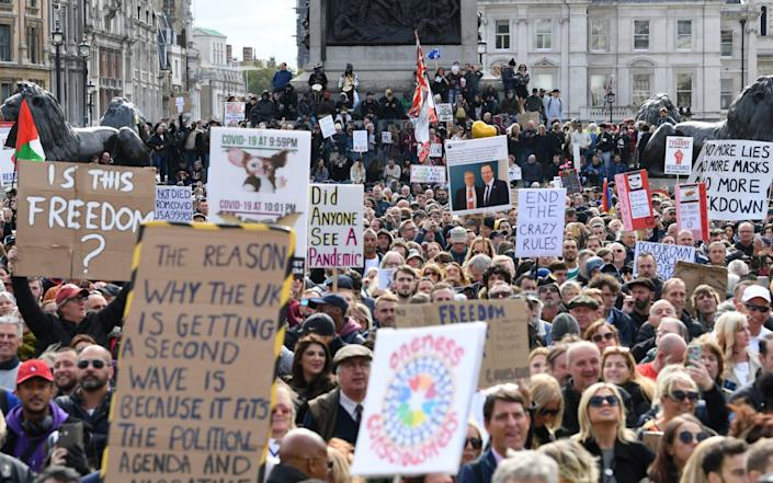People take part in a 'We Do Not Consent' rally at Trafalgar Square in London, - Stefan Rousseau/ PA