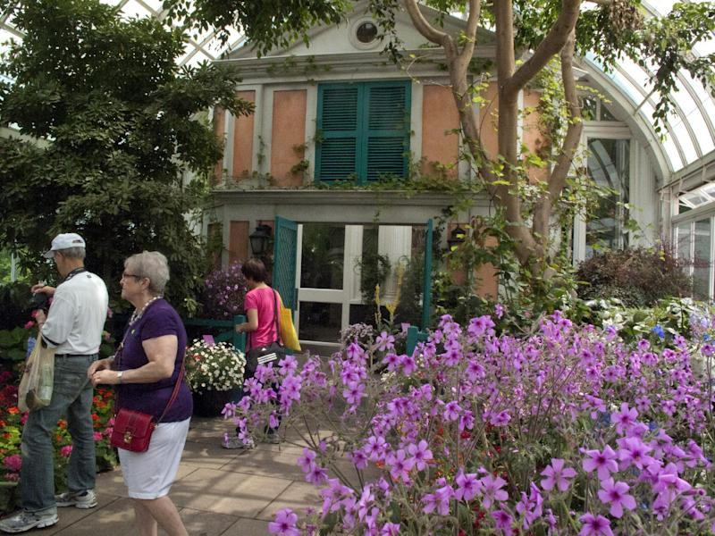 "In this May 26, 2012 photo, a replica of the facade of French impressionist artist Claude Monet's pink stucco house is featured in an exhibition at the New York Botanical Garden in New York. ""Monet's Garden,"" evokes the artist's garden at Giverny, his home in France from 1883 until his death in 1926. It runs through Oct. 21. (AP Photo/Ray Stubblebine)"