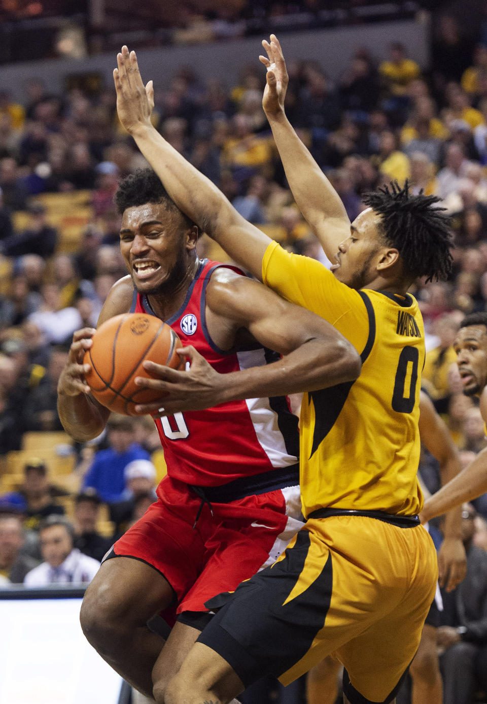 Mississippi's Blake Hinson, left, pushes his way past Missouri's Torrence Watson, right, during the first half of an NCAA college basketball game Saturday, March 9, 2019, in Columbia, Mo. (AP Photo/L.G. Patterson)