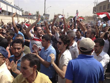 Protesters demand that the pensions of parliamentarians be cancelled during a demonstration in Baghdad August 31, 2013. Thousands are rallying across Iraq against corruption and the financial privileges of lawmakers and political leaders. REUTERS/Thaier al-Sudani