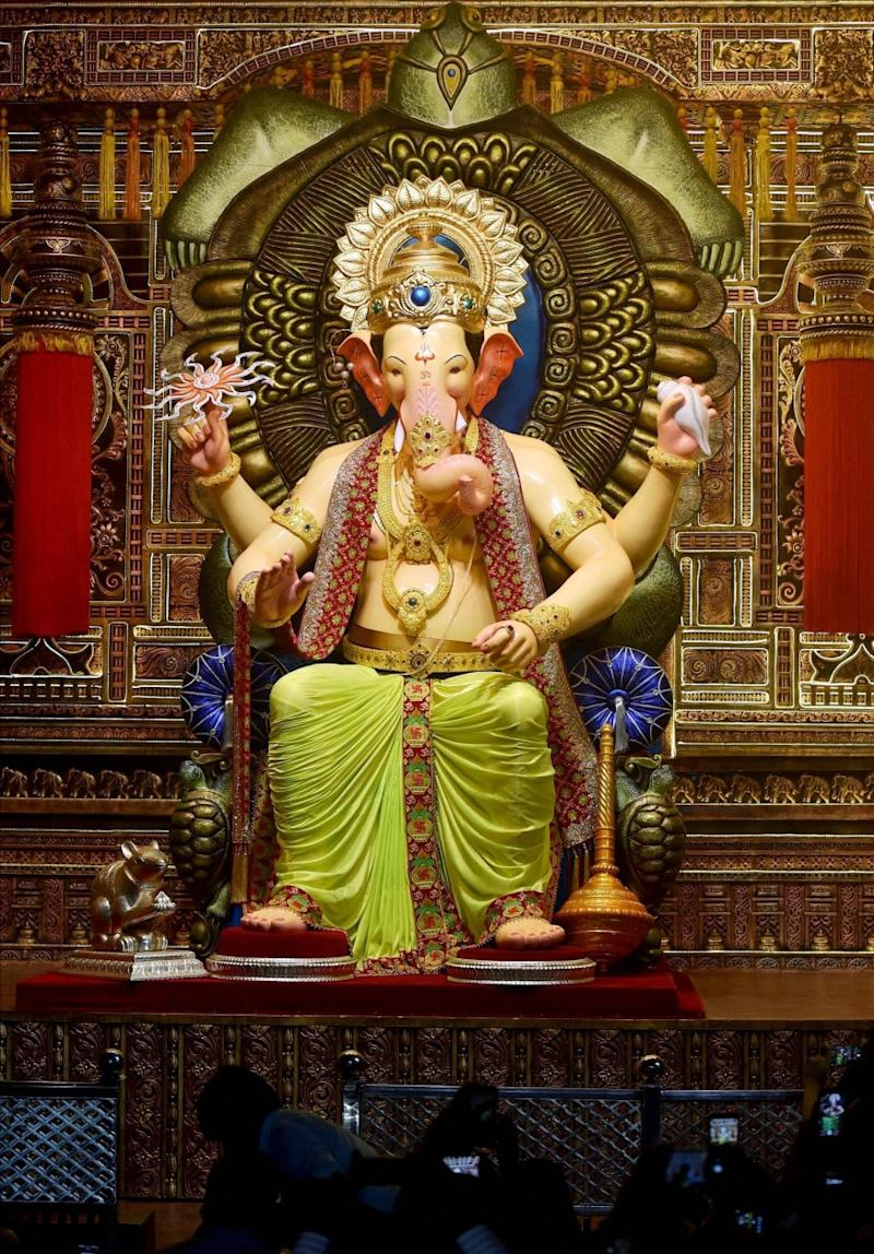 It will be replaced by a small idol of around 3-4 feet for the traditional 'puja' and other ceremonies, at the 127-year-old 11-day Ganesha festival, which starts on August 22. (Image: PTI)