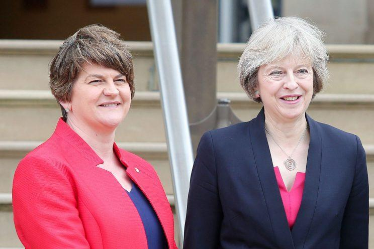 DUP leader Arlene Foster (left) could end up in power with the Tories in a coalition government (Press Eye Ltd/REX/Shutterstock)