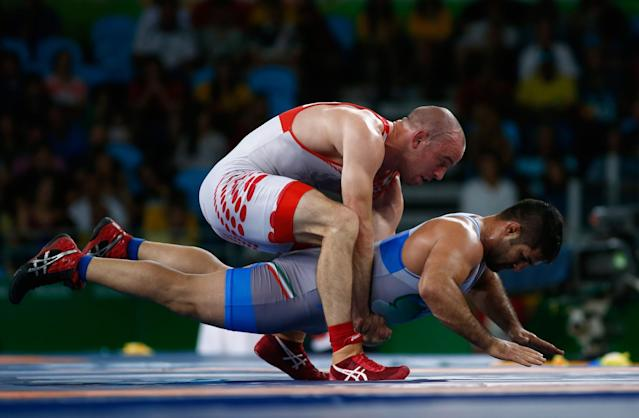 <p>Saeid Morad Abdvali of Iran competes against Mark Overgaard Madsen of Denmark during the Men's 75 kg Greco-Roman Wrestling 1/8 Finals on Day 9 of the Rio 2016 Olympic Games at the Carioca Arena 2 on August 15, 2016 in Rio de Janeiro, Brazil. (Photo by Phil Walter/Getty Images) </p>