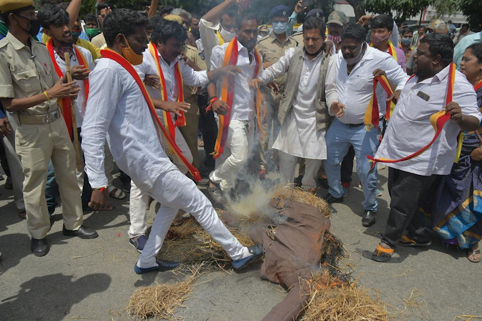 Activists belonging to various farmers rights organisations burn the effigy of Karnataka Chief Minister B. S. Yediyurappa during an anti-government demonstration to protest against the recent passing of new farm bills in parliament, in Bangalore on September 28, 2020. (Photo by Manjunath Kiran / AFP) (Photo by MANJUNATH KIRAN/AFP via Getty Images)