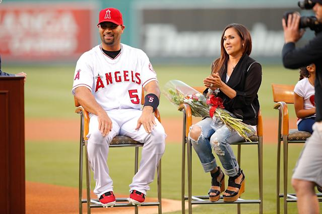 "<a class=""link rapid-noclick-resp"" href=""/mlb/players/6619/"" data-ylk=""slk:Albert Pujols"">Albert Pujols</a> is welcomed into the 500 Homerun Club next to his wife Deidre at Angel Stadium of Anaheim on June 7, 2014 in Anaheim, California. (Getty Images)"