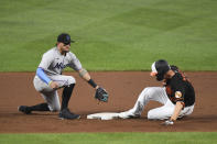 Baltimore Orioles' Trey Mancini avoids the tag from Miami Marlins shortstop Miguel Rojas and slides into second base for a double during the fourth inning of a baseball game Tuesday, July 27, 2021, in Baltimore. (AP Photo/Terrance Williams)