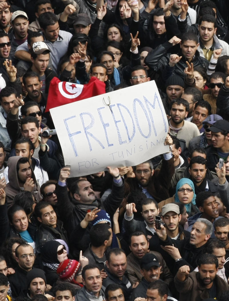 Protesters chant slogans against President Zine El Abidine Ben Ali in Tunis, Friday, Jan. 14, 2011.  Demonstrators marched through the Tunisian capital Friday, demanding the resignation of the country's autocratic leader a day after he appeared on TV to try to stop deadly riots that have swept the North African nation. (AP Photo/Christophe Ena)
