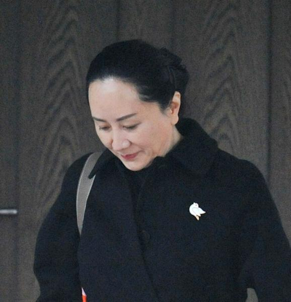 Huawei chief financial officer Meng Wanzhou, seen here leaving her Vancouver home January 22, is fighting extradition to the United States (AFP Photo/Don MacKinnon)