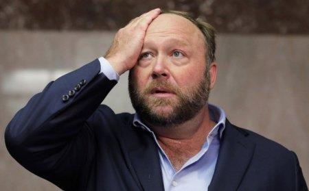 FILE PHOTO: Alex Jones of Infowars talks to the media while visiting the U.S. Senate's Dirksen Senate office building as Twitter CEO Jack Dorsey testifies before a Senate Intelligence Committee hearing on Capitol Hill in Washington, U.S., September 5, 2018. REUTERS/Jim Bourg