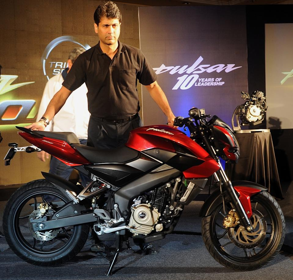 Bajaj Auto managing director Rajiv Bajaj unveils the new Pulsar 200NS motorcycle in Mumbai on January 30, 2012. The latest motorcycle from the stable of one of India's major two-wheeler manufacturer, Bajaj, will be commercially launched in the begining of the next fiscal year. AFP PHOTO/Indranil MUKHERJEE