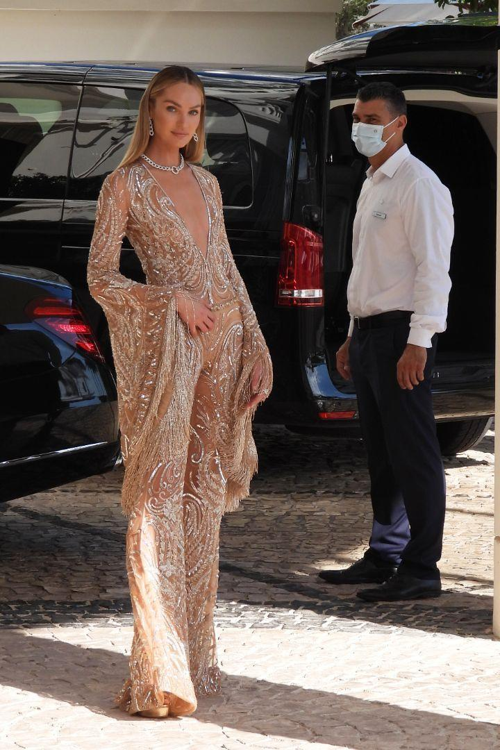 Candice Swanepoel leaves hotel Martinez in Cannes, France, to attend the opening ceremony of Cannes Film Festival 2021 - Credit: MCFR/Splash News