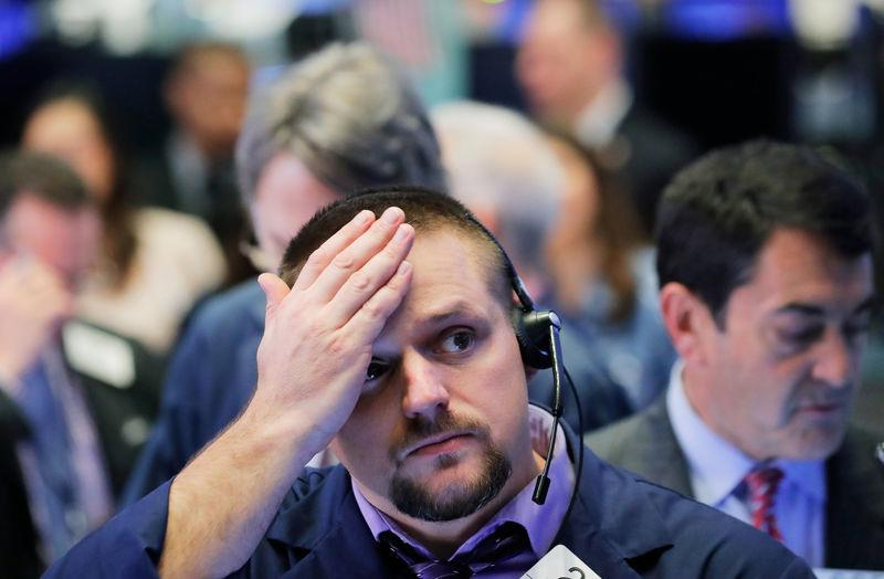 A trader works on the floor of the New York Stock Exchange (NYSE) in Manhattan in New York, U.S., October 11, 2018. REUTERS/Brendan McDermid
