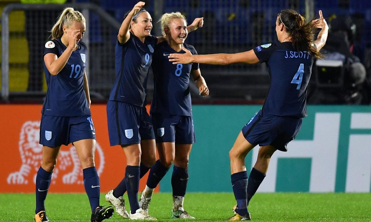 Jodie Taylor, second left, celebrates with her team-mates after scoring in England's 2-0 win against Spain, a second consecutive victory for the Lionesses at Euro 2017.
