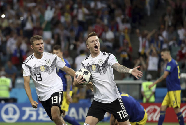 Germany's Marco Reus, center, celebrates with Thomas Mueller after scoring his side's opening goal during the group F match between Germany and Sweden at the 2018 soccer World Cup in the Fisht Stadium in Sochi, Russia, Saturday, June 23, 2018. (AP Photo/Thanassis Stavrakis)