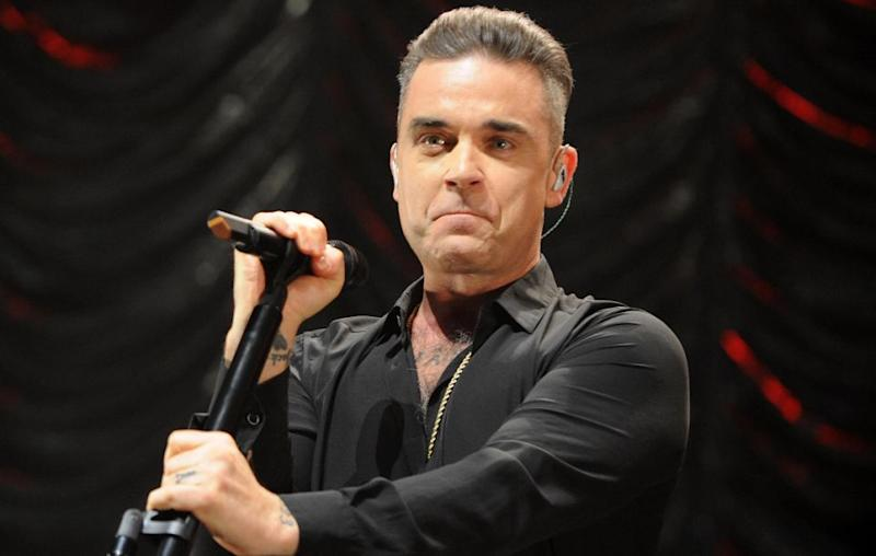 Robbie recently revealed he suffers from a rare eating disorder causing him to unknowingly to eat at night. Source: Getty