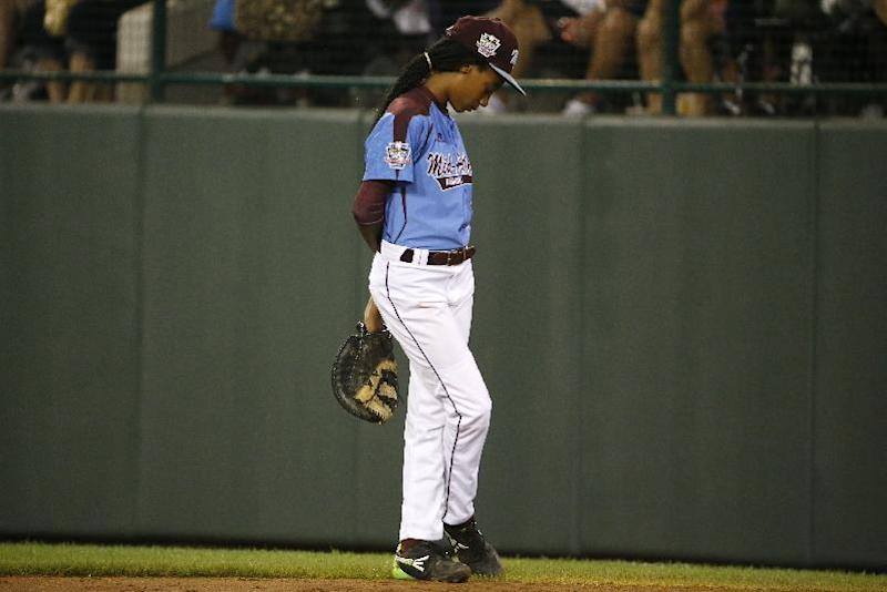 Philadelphia pitcher Mo'ne Davis stands at first base after being removed as pitcher in the third inning of a United States semi-final baseball game against Las Vegas at the Little League World Series tournament in South Williamsport, Pa., Wednesday, Aug. 20, 2014. (AP Photo/Gene J. Puskar)
