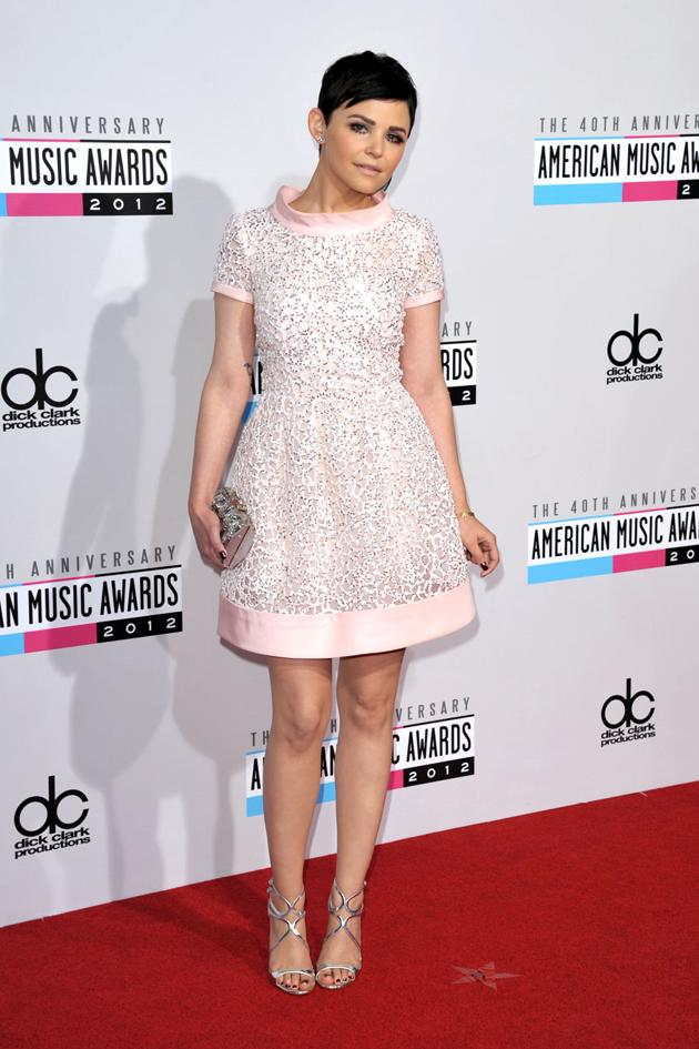 AMAs 2012: Actress Ginnifer Goodwin gives us a lesson in girly fashion, by rocking this cute pale pink prom dress with embellishment. The dark eye makeup off-sets the sweetness. We love. Copyright [PA]