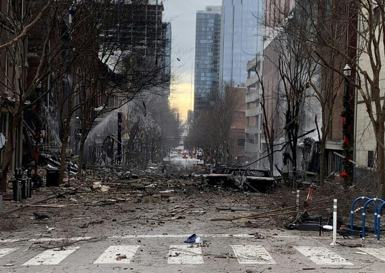 In this photo from the Twitter page of the Nashville Fire Department, damage is seen on a street after an explosion in Nashville, Tennessee on December 25, 2020
