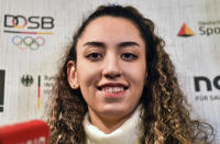 Iranian Taekwondo athlete Kimia Alizadeh speaks to the media at a press conference in Luenen, Germany, Friday, Jan. 24, 2020. Iran's only female Olympic medalist fled from the Islamic Republic and said she wants to compete for Germany. (AP Photo/Martin Meissner)