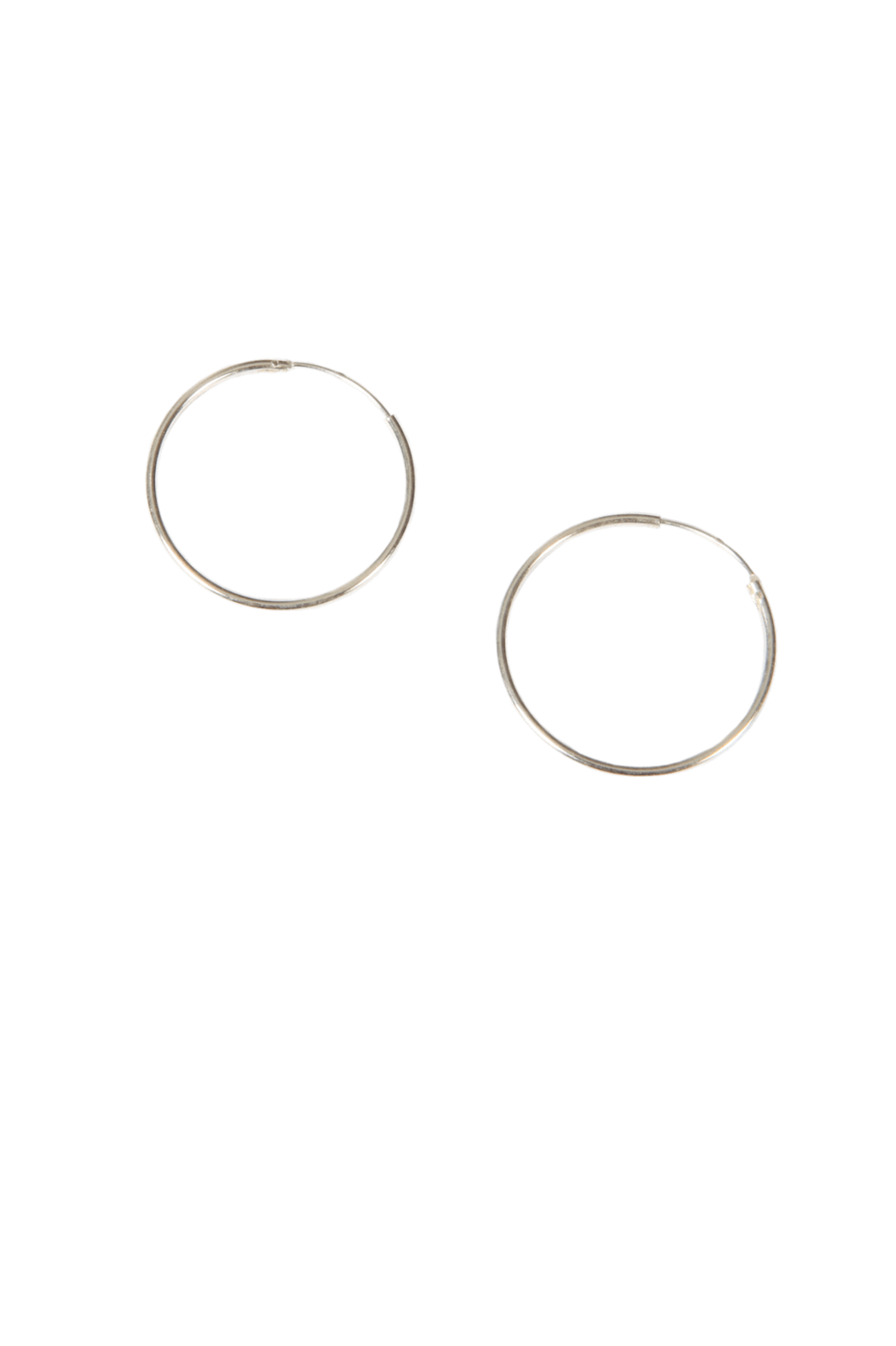 "<br><br><strong>Birdsong</strong> Medium Silver Hoop Earrings, $, available at <a href=""https://birdsong.london/collections/jewellery/products/medium-silver-hoops-1"" rel=""nofollow noopener"" target=""_blank"" data-ylk=""slk:Birdsong"" class=""link rapid-noclick-resp"">Birdsong</a>"