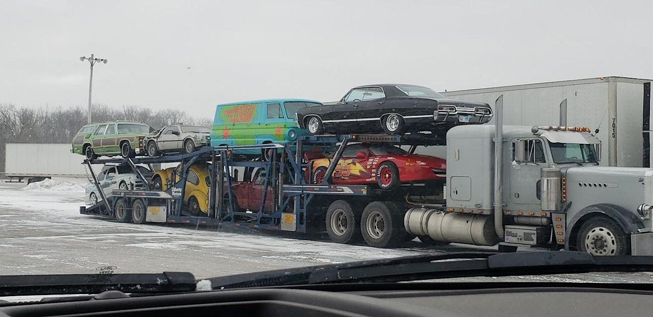 <p>Reader Travis Webb sent us this behind-the-scenes photo of some movie cars on a transporter, including the Family Truckster, the Delorean, the Mystery Machine, and Bumblebee. Were these the cars from the ad? Perhaps not, but it's a fun coincidence nonetheless.</p>