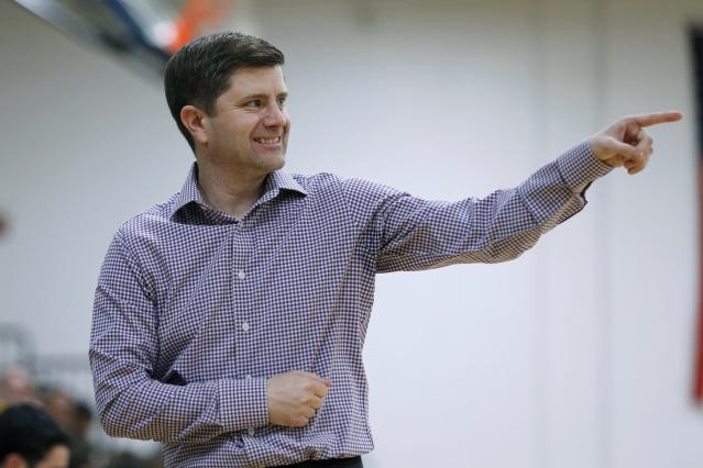 In this Thursday, Feb. 27, 2020 photo, Merrimack College head coach Joe Gallo reacts along the sideline during the second half of an NCAA college basketball game against Central Connecticut in North Andover, Mass. The Warriors have been one of the biggest surprises in college basketball, winning more games than any other first-year Division I program in history. (AP Photo/Mary Schwalm)