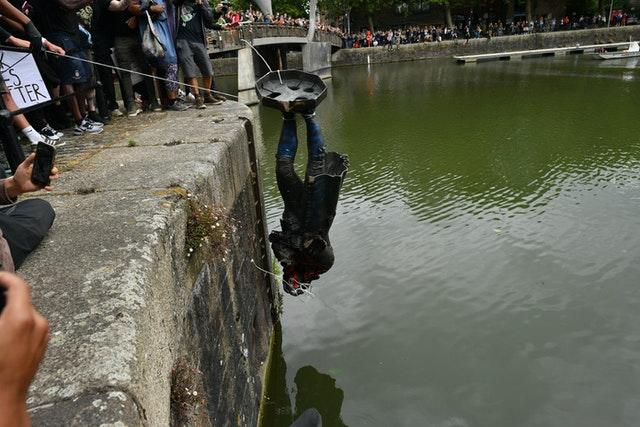 Protesters throw the statue of Edward Colston into Bristol harbour