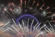 Fireworks explode around the London Eye wheel during New Year celebrations in central London January 1, 2014. REUTERS/Toby Melville