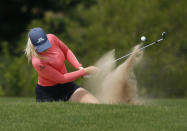 Matilda Castren, of Finland, plays a shot out of a fairway bunker on the 12th hole during the final round of the LPGA Volunteers of America Classic golf tournament in The Colony, Texas, Sunday, July 4, 2021. (AP Photo/Ray Carlin)