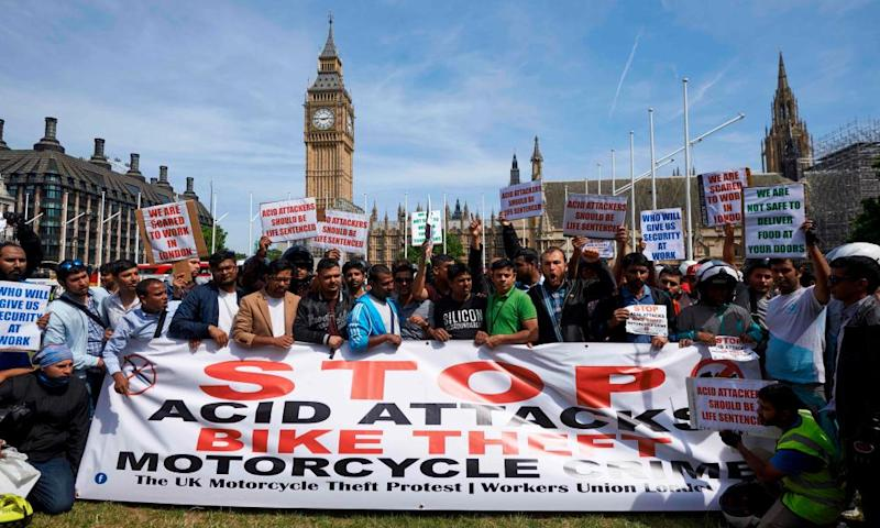 An acid attack protest in Parliament Square, central London