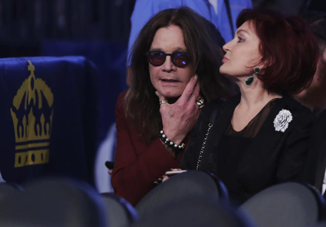 <p>Ozzy Osbourne, left, and his wife Sharon wait for the super welterweight boxing match between Floyd Mayweather Jr. and Conor McGregor, Saturday, Aug. 26, 2017, in Las Vegas. (AP Photo/Isaac Brekken) </p>