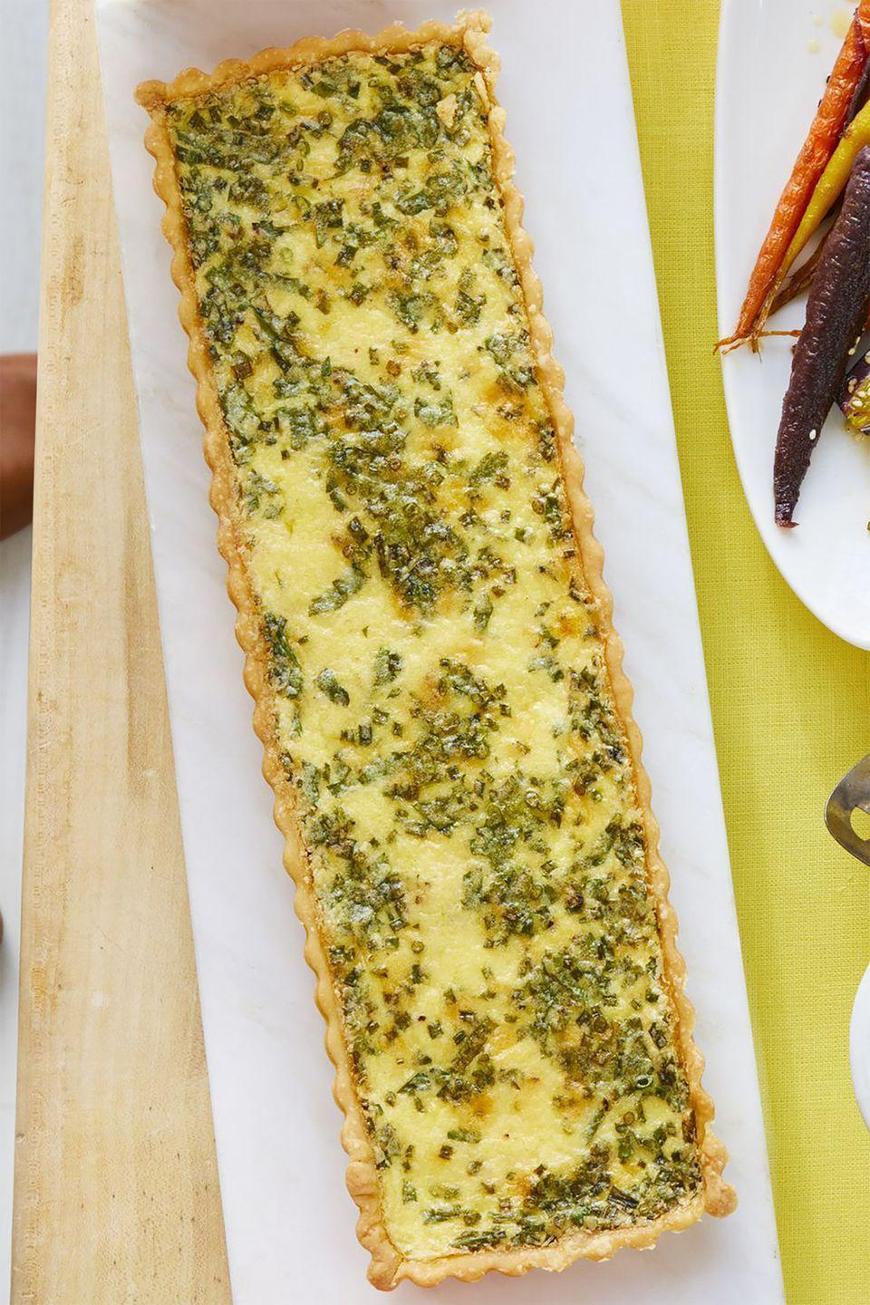 """<p>This deliciously cheesy quiche is sure to make Mom's morning. </p><p><strong><a href=""""https://www.womansday.com/food-recipes/food-drinks/a19122269/cheese-and-herb-quiche-recipe/"""" rel=""""nofollow noopener"""" target=""""_blank"""" data-ylk=""""slk:Get the Cheese-and-Herb Quiche recipe."""" class=""""link rapid-noclick-resp""""><em>Get the Cheese-and-Herb Quiche recipe.</em></a> </strong></p>"""