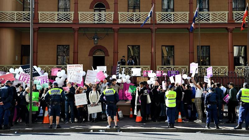 Anti-abortion and pro-choice advocates rally outside NSW Parliament as a debate on the issue begins