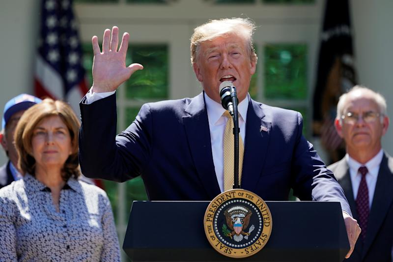 U.S. President Donald Trump speaks about healthcare coverage options for small businesses and workers during an event in the Rose Garden of the White House in Washington, U.S., June 14, 2019. REUTERS/Kevin Lamarque