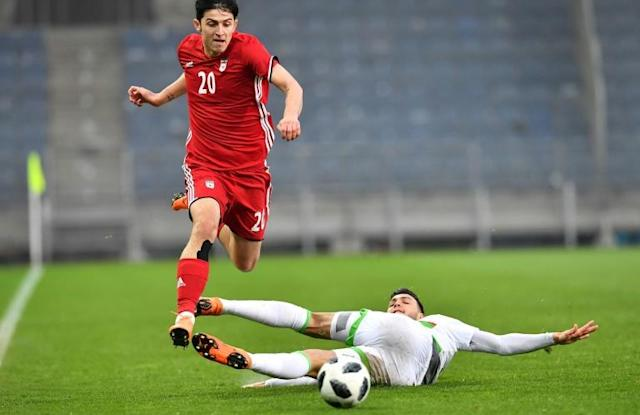 Iran's Sardar Azmoun tunes up for the World Cup in a friendly against Algeria