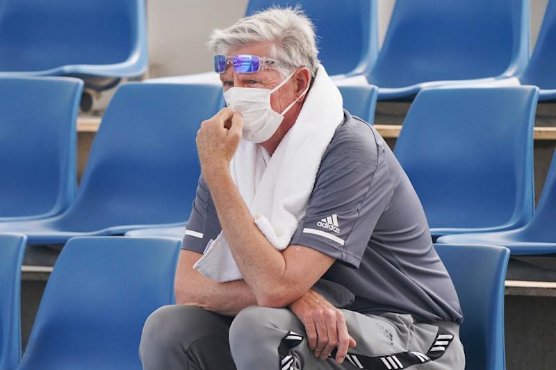 """A spectator wears a mask as smoke haze shrouds Melbourne during an Australian Open practice session at Melbourne Park in Australia, Tuesday, Jan. 14, 2020. Smoke haze and poor air quality caused by wildfires temporarily suspended practice sessions for the Australian Open at Melbourne Park on Tuesday, but qualifying began later in the morning in """"very poor"""" conditions and amid complaints by at least one player who was forced to forfeit her match. (Michael DodgeAAP Image via AP) (Photo: ASSOCIATED PRESS)"""