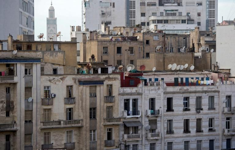 Clotheslines, satellite dishes and tangled cables have sprouted on the deteriorating facades of central Casablanca's buildings, constructed nearly a century ago under French rule