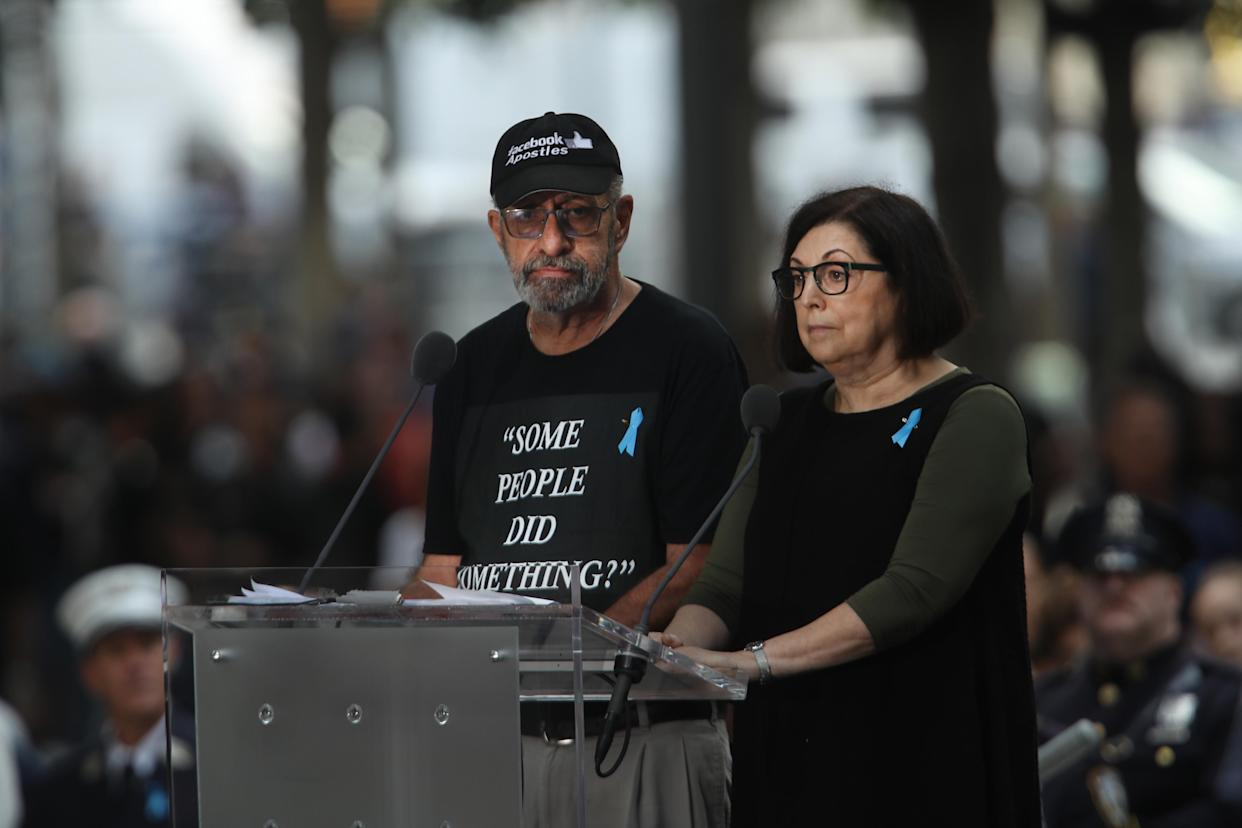 Nicholas Haros, who lost his mother, Frances, in the Sept. 11, 2001, terrorist attacks, wears a shirt critical of Rep. Ilhan Omar's comments while reading names at the National September 11 Memorial on September 11, 2019 in New York City. (Photo: Spencer Platt/Getty Images)