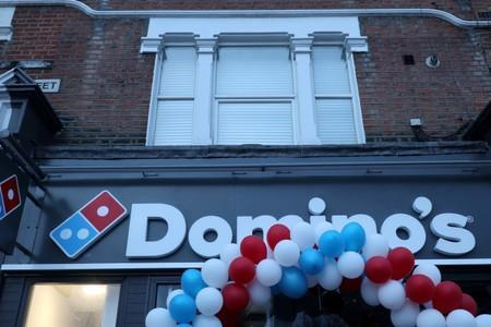 FILE PHOTO: Balloons are seen on the front of a newly opened Domino's Pizza franchise in London, Britain