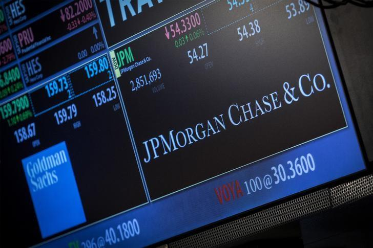 A screen displays JP Morgan Chase & Co. at the post that the stock is traded at on the floor of the New York Stock Exchange