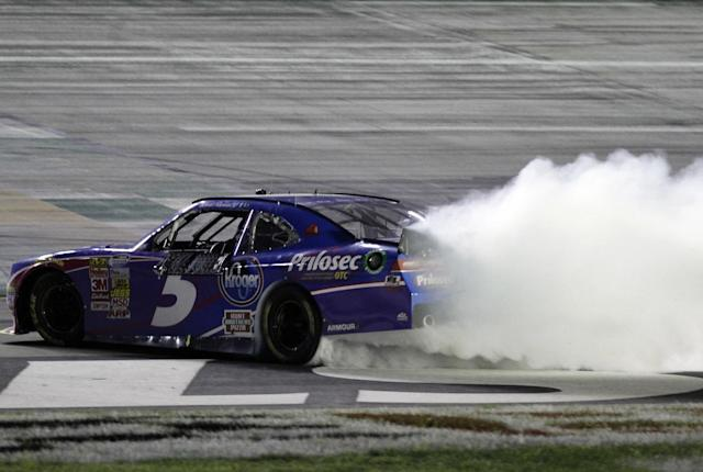 Kevin Harvick does a burnout after winning the NASCAR Nationwide series auto race at Kentucky Speedway in Sparta, Ky., Friday June 27, 2014. (AP Photo/Garry Jones)