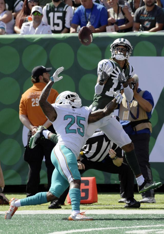 <p>Miami Dolphins cornerback Xavien Howard (25) New York Jets wide receiver Robby Anderson (11) fight for the ball in the end zone during the first half of an NFL football game Sunday, Sept. 24, 2017, in East Rutherford, N.J. (AP Photo/Bill Kostroun) </p>